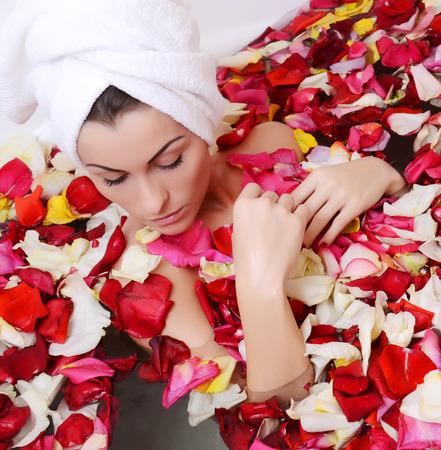 roseleaf: Beautiful female in bath with rose petal. Body care.