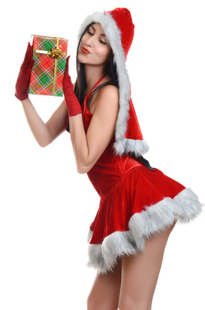 Beautiful and sexy woman wearing santa clause costume with gift photo