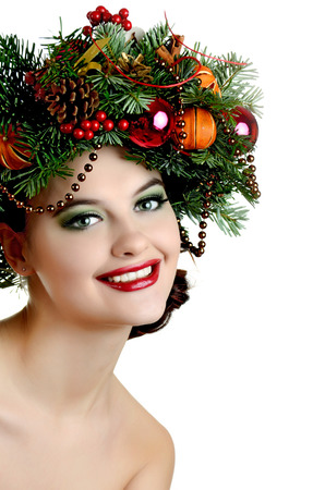Christmas Woman.  New Year and Christmas Holiday Hairstyle and Make up photo