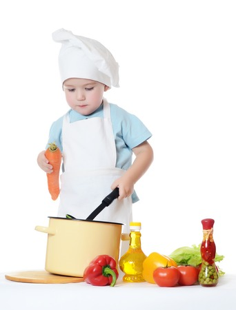 a little dinner: The little boy in hat of cook Stock Photo
