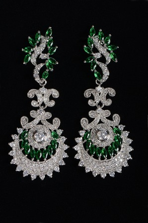 jewels: Silver earrings with jewels on the black
