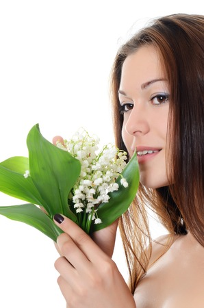 womanliness: The beautiful woman holds a flower of a lily of the valley