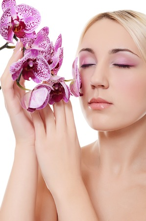 The beautiful young woman with flowers orchid photo