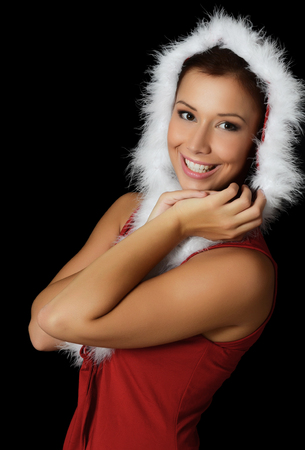 The Christmas girl on a black background photo