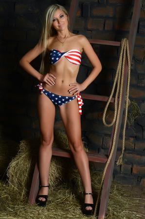 barns: The beautiful woman in bikini on hay Stock Photo