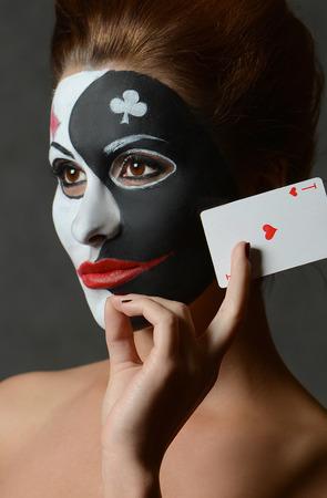 joker card: Girl in image of joker with cards in studio shoot