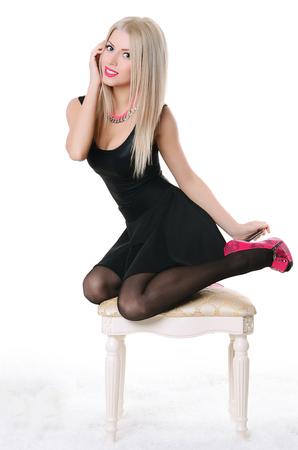 cute teen: Beautiful sensual woman sits on a chair