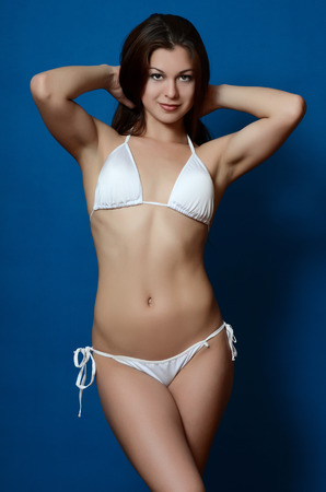 beautiful breasts: The girl in bikini on blue background Stock Photo