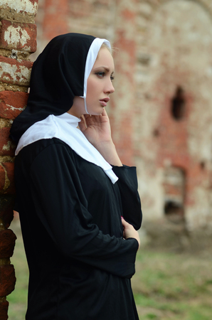 chastity: portrait of a young nun outdoor