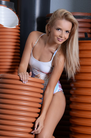 sewer pipe: The sexual girl with PVC pipes
