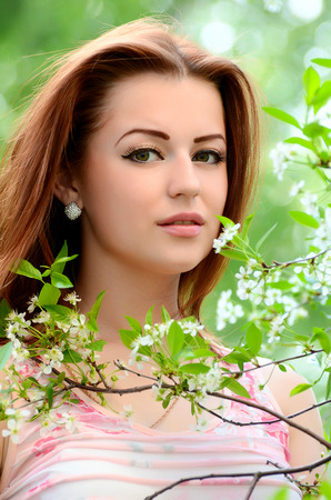 flowers garden: The beautiful woman in flowers of cherry