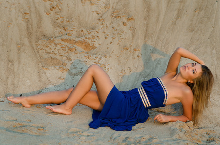 summer dress: The beautiful woman in dress on sand