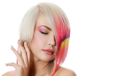 color model: Woman with bright make-up and multi-coloured strand in hair