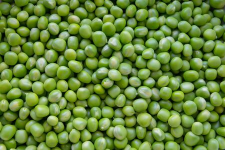 Background of young juicy green peeled peas mound Standard-Bild