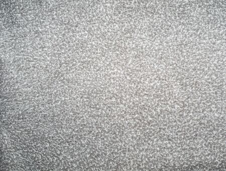 Light gray background with white specks. Background from gray matter