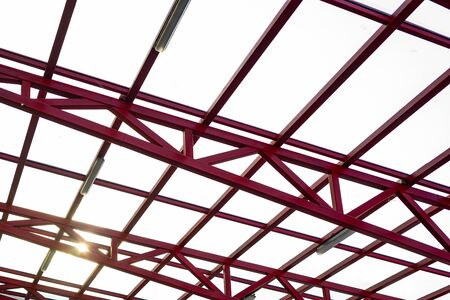 The glass roof is mounted on a metal frame which is painted red Standard-Bild