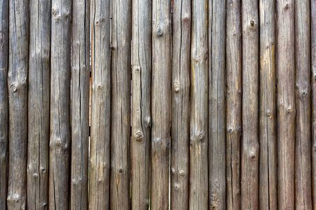 Fence with small wooden trunks. The wooden fence is outdated. Background 版權商用圖片