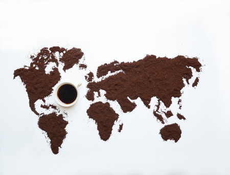 Isolated ground coffee and the world Stock Photo