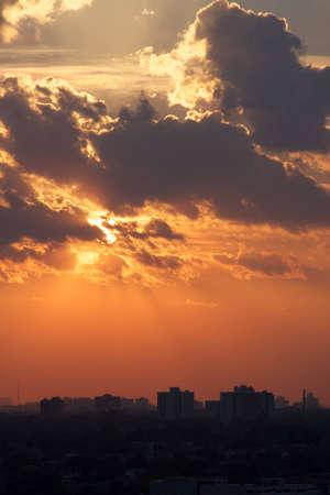 Orange sunset over silhouette horizon