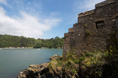 old english: An old English castle wall beside the river Stock Photo