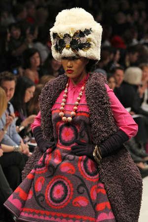 toronto fashion week: TORONTO - MARCH 12 2012: A model walks the runway in the Korhani Home runway show for the FallWinter 2012 season at Torontos World Mastercard Fashion Week on March 12th 2012.