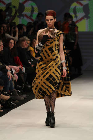 TORONTO - MARCH 12 2012: A model walks the runway in the Korhani Home runway show for the FallWinter 2012 season at Toronto's World Mastercard Fashion Week on March 12th 2012.