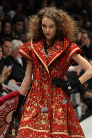world master card fashion week: TORONTO - MARCH 12 2012: A model walks the runway in the Korhani Home runway show for the FallWinter 2012 season at Torontos World Mastercard Fashion Week on March 12th 2012.