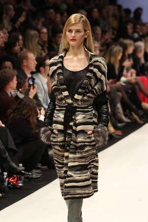 toronto fashion week: TORONTO - MARCH 12: A model walks the runway in the Holt Renfrew Presents runway show for the FallWinter 2012 season at Torontos World Mastercard Fashion Week on March 12th 2012. Editorial