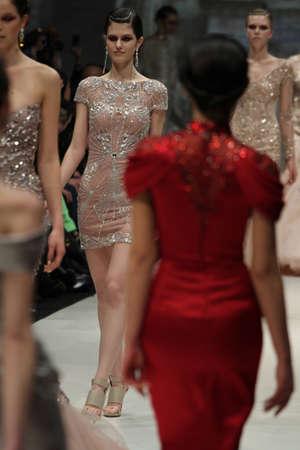 toronto fashion week: TORONTO - MARCH 12: Models walk the runway in the Pavoni runway show for the FallWinter 2012 season at Torontos World Mastercard Fashion Week on March 12th 2012.