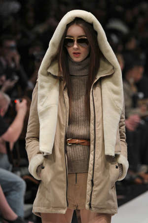 toronto fashion week: TORONTO - MARCH 13: A model walks the runway in the Soia & Kyo runway show for the FallWinter 2012 season at Torontos World Mastercard Fashion Week on March 13th 2012.