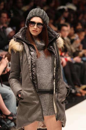 world master card fashion week: TORONTO - MARCH 13: A model walks the runway in the Soia & Kyo runway show for the FallWinter 2012 season at Torontos World Mastercard Fashion Week on March 13th 2012.