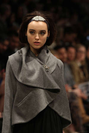 toronto fashion week: TORONTO - MARCH 13: A model walks the runway in the Lundstrom Collection runway show for the FallWinter 2012 season at Torontos World Mastercard Fashion Week on March 13th 2012.