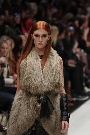 toronto fashion week: TORONTO - MARCH 15: A model walks the runway in the Rudsak runway show for the FallWinter 2012 season at Torontos World Mastercard Fashion Week on March 15th 2012.