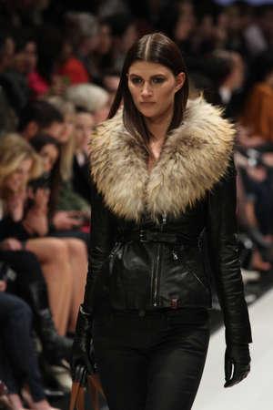 world master card fashion week: TORONTO - MARCH 15: A model walks the runway in the Rudsak runway show for the FallWinter 2012 season at Torontos World Mastercard Fashion Week on March 15th 2012.