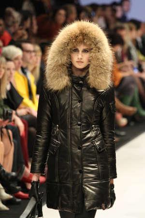 TORONTO - MARCH 15: A model walks the runway in the Rudsak runway show for the FallWinter 2012 season at Torontos World Mastercard Fashion Week on March 15th 2012.