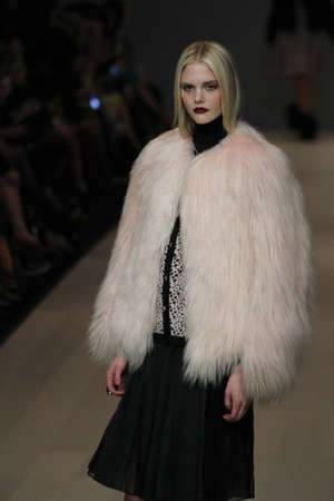 TORONTO - MARCH 15: A model walks the runway in the Pink Tartan runway show for the FallWinter 2012 season at Torontos World Mastercard Fashion Week on March 15th 2012.
