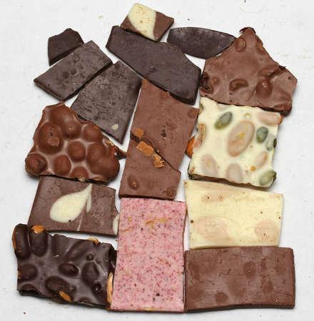 Blocks of Chocolate on a white backdrop. Stock Photo