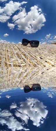 mirroring: sunglasses mirroring in the water Stock Photo