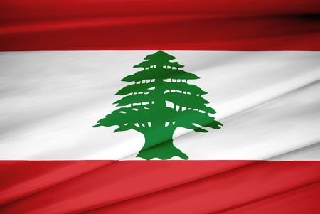 national flag of Lebanon waving in the wind photo