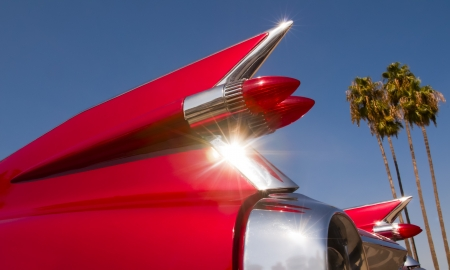 fins: Red Cadillac with a blue California sky in the background