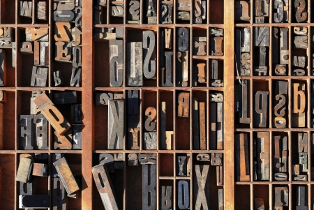 letterpress letters: A box of old vintage printing press letter blocks in a old wooden box Stock Photo