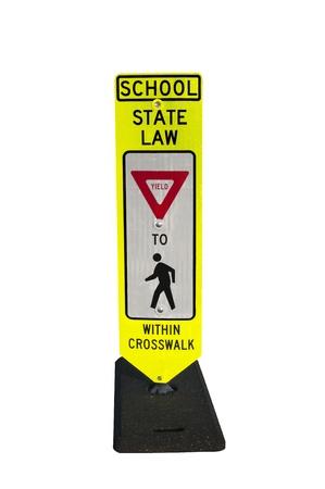 School crosswalk road sign alerting motorist to yield to pedestrians.