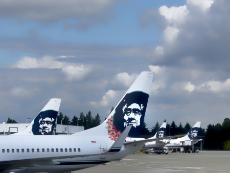 SEATTLE, WA  USA -JUNE 13, 2013  Alaska Airlines jets at the Seattle  Airport waiting to be  loaded with passengers and luggage