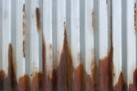 Corrugated rusting metal in sunlight makes for a great background  Imagens