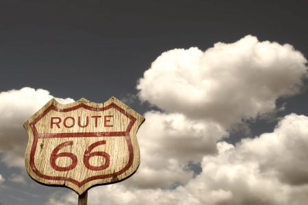 Iconic Route 66 sign framed by the blue cloudy sky