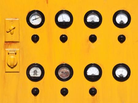 Vintage yellow and black gauge panel Imagens