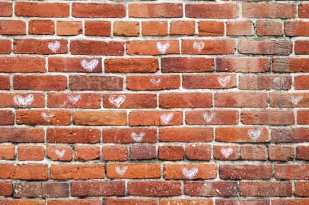 bricks background: Vintage old red brickwall with a heart pattern