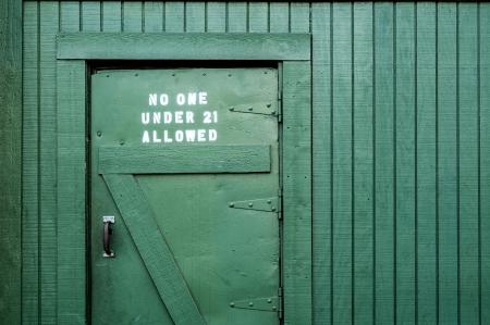 irish pub label design: Irish pub back door with a warning sign