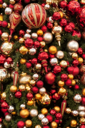 A 100 colorful ornaments hanging on a Christmas Tree