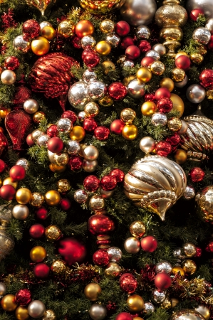 A 100 colorful ornaments hanging on a Christmas Tree Imagens - 24526151